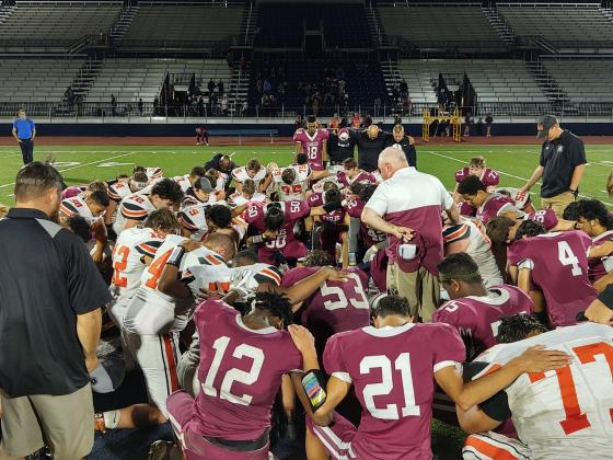 OCA and Crescent players gather for a postgame prayer