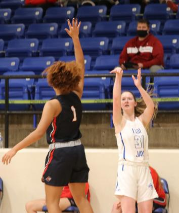 Kyra Wheeler shoots a 3-pointer